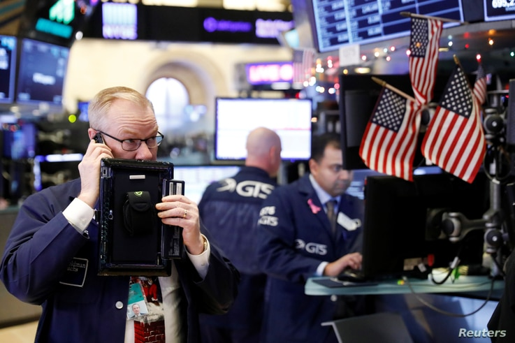 Traders work on the floor of the New York Stock Exchange shortly after the opening bell in New York, Dec. 24, 2018.