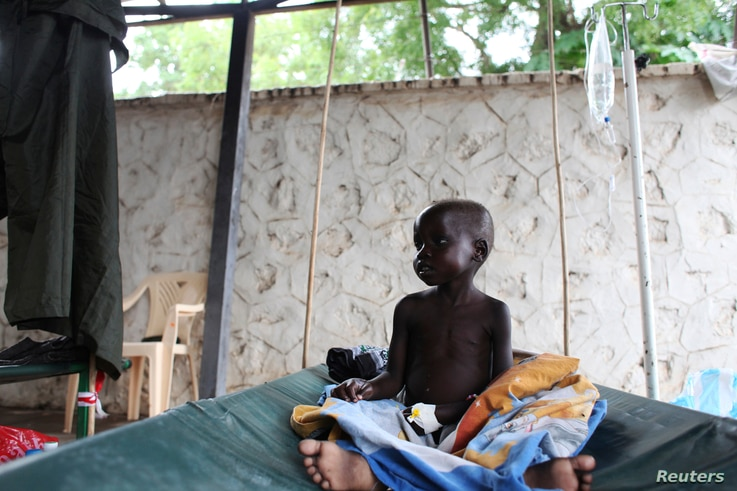 A South Sudanese child suffering from cholera sits on a bed in Juba Teaching Hospital in Juba, May 27, 2014.