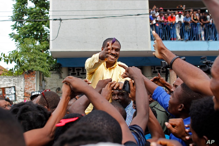 Presidential candidate Jude Celestin, from the LAPEH party, greets supporters after voting in the Petion-Ville suburb of Port-au-Prince, Haiti, Nov. 20, 2016.