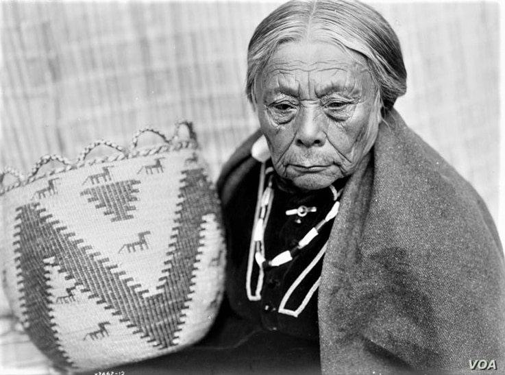 This ca. 1913 photo by Edward S. Curtis shows a Skokomish woman from Washington state holding a woven basket. Tribal arts and crafts draw on traditions passed down for generations.
