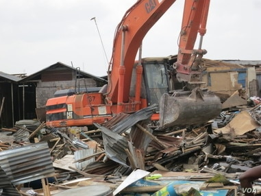 A bulldozer demolishes homes in Badia East, Lagos, Nigeria, February 23, 2013. (Social and Economic Rights Action Center (SERAC))