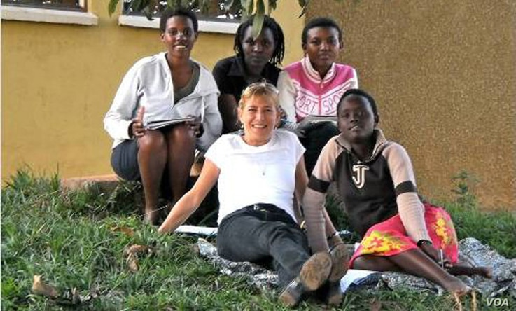 Anne Heyman with some of the youth village residents.  Credit: ASYV