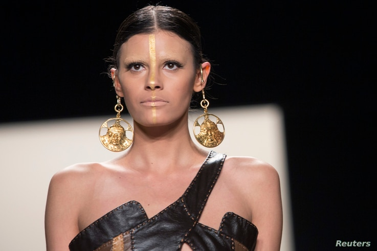 A model presents a creation from the Katya Zol 2014 Fall/Winter collection during New York Fashion Week, Feb. 9, 2014.