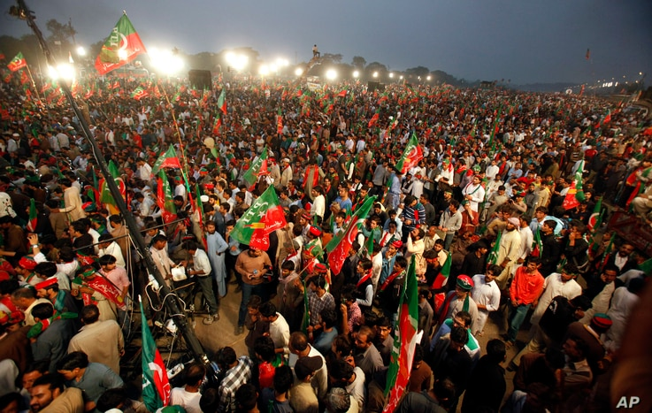 Supporters of the opposition Pakistan Tehreek-e-Insaf party wave party flags while taking part in a rally in Islamabad, Pakistan, Nov. 2, 2016.