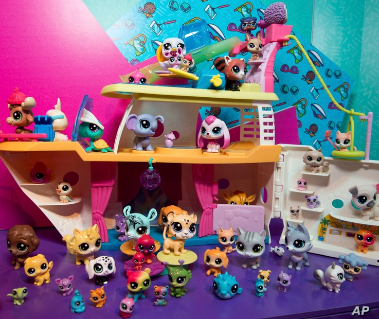 FILE -  A demonstrator in the Hasbro showroom during the American International Toy Fair plays with the LITTLEST PET SHOP CRUISE SHIP playset.