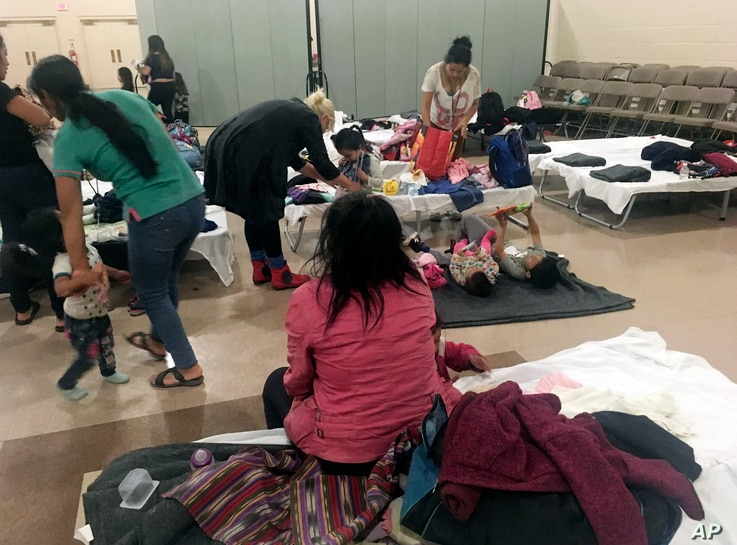 FILE - Guatemalan migrant Cirila Alejandra Calelpu, 20, sitting, rests at the Cathedral of the Immaculate Heart of Mary migrant shelter in Las Cruces, N.M., after she and her 3-year-old daughter were released from U.S. Immigration and Customs Enforce...