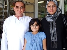 Iraqi Wisam Alani, his wife and their nine-year-old daughter attend midday prayer service at the ADAMS center mosque, 13 Aug 2010