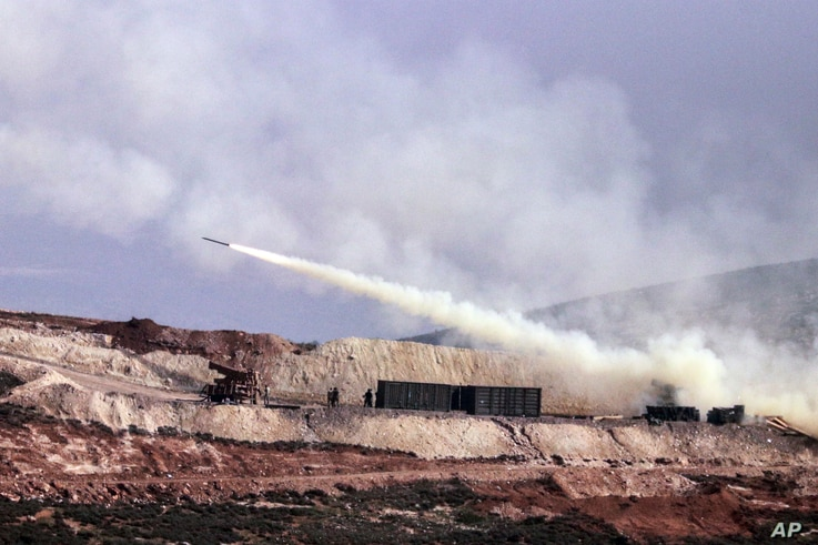 Turkish artillery fires toward Syrian Kurdish positions in Afrin area, Syria, from Turkish side of the border in Hatay, Turkey,  Feb. 9, 2018. Turkish jets have resumed airstrikes in the Syrian Kurdish-run enclave of Afrin, the military and media rep...