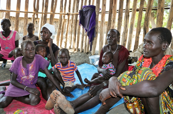FILE - Families, recently displaced by conflict, shelter in a run-down school in Akobo, South Sudan, Jan. 19, 2018.