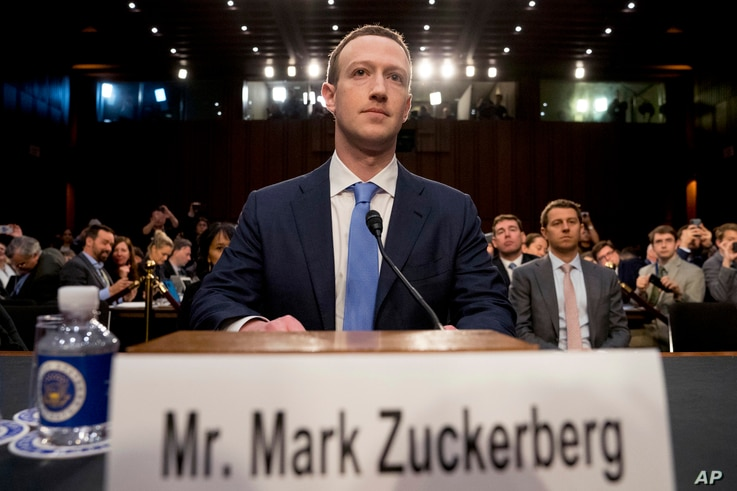 Facebook CEO Mark Zuckerberg arrives to testify before a joint hearing of the Senate Commerce and Judiciary committees on Capitol Hill in Washington, April 10, 2018, about the use of Facebook data to target American voters in the 2016 election.