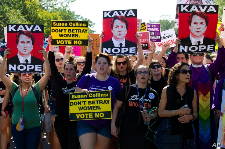 Demonstrators protest against Supreme Court nominee Brett Kavanaugh as they march to the U.S. Supreme Court, Oct. 4, 2018, in Washington.