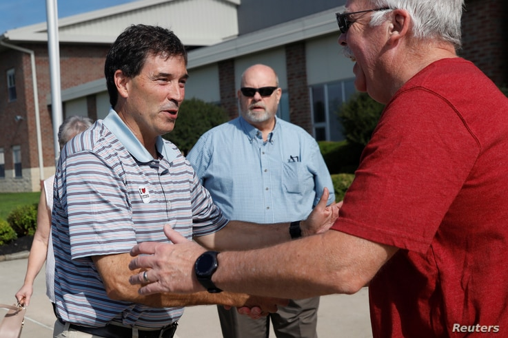 Republican candidate Troy Balderson, in Ohio's 12th congressional district, shakes hands with a voter at a polling station during Tuesday's special election in Newark, Ohio, Aug. 7, 2018.