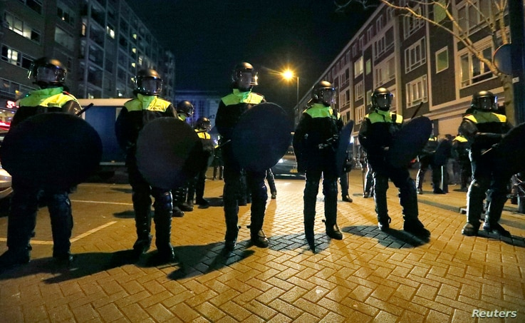 Police block off the street outside the Turkish consulate in Rotterdam where a crowd gathered to await the arrival of the Turkish Family Minister Fatma Betul Sayan Kaya, who decided to travel to Rotterdam by land after Turkish Foreign Minister Mevlut...