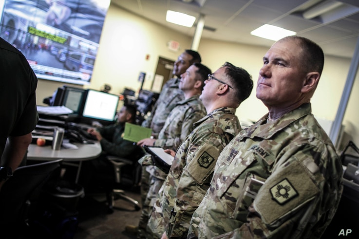 FILE - Image provided by US Customs and Border Protection shows members of the New Mexico Army National Guard liaison team visiting the US Border Patrol El Paso Sector Intelligence Operations Center, April 7, 2018. (U.S. Customs and Border Protection