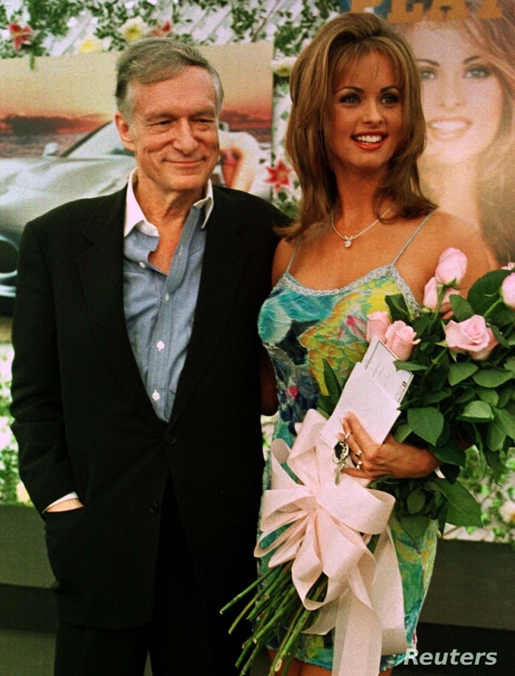 FILE - Karen McDougal, who had recently been named Playboy magazine's Playmate of the Year, poses with Playboy founder Hugh Hefner, May 28, 1998, during ceremonies at the Playboy Mansion in Beverly Hills, Calif. McDougal on March 20, 2018, filed a la...
