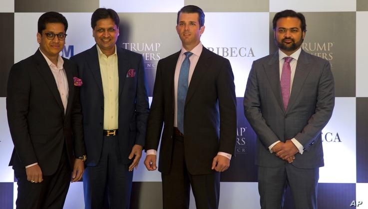 The eldest son of U.S. President Donald Trump, Donald Trump Jr., second from right,  poses with promoters of Trump Towers in New Delhi, India, Feb. 20, 2017.