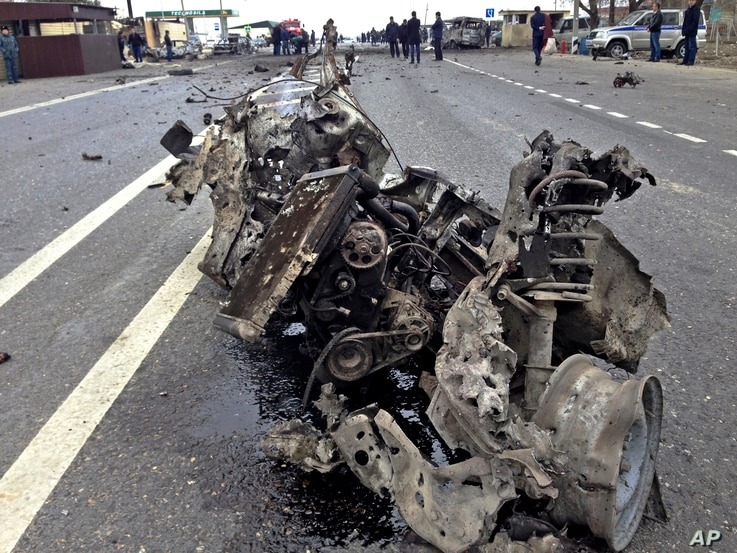 The wreckage of a suicide bomber's car is seen near a traffic police check point near Derbent in Russia's northern Caucasus region of Dagestan on Monday, Feb. 15, 2016.