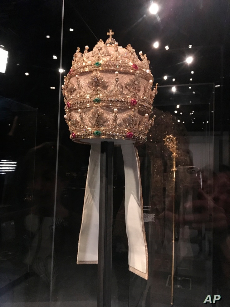 "A jewel-encrusted papal tiara from the Sistine Chapel sacristy at the Vatican is displayed at the Metropolitan Museum of Art in its ""Heavenly Bodies: Fashion and the Catholic Imagination,"" the spring fashion exhibit at the museum's Costume Inst..."