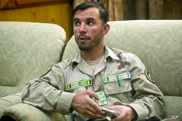 Afghanistan Aug. 4, 2016 photo, Gen. Abdul Raziq, Kandahar police chief, speaks during an interview with The Associated Press in Kandahar
