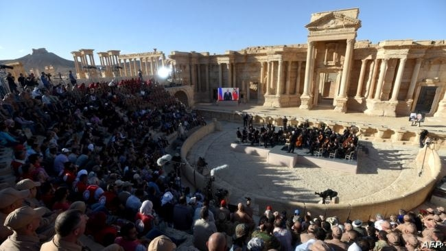 Russian conductor Valery Gergiyev leads a concert in the amphitheater of the ancient city of Palmyra in May 2016.