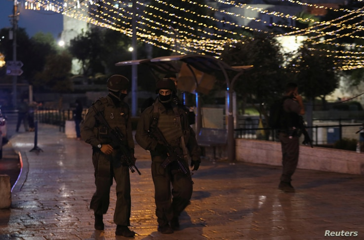 Israeli policemen secure the scene of the shooting and stabbing attack outside Damascus gate in Jerusalem's Old City June 16, 2017.