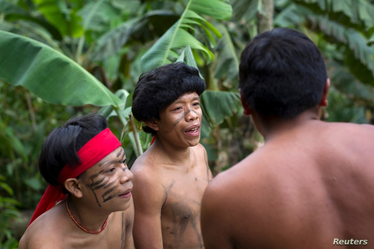 Yanomami Indians chat at the community of Irotatheri, during a government trip for journalists, in the southern Amazonas state of Venezuela, just 19km (12 miles) from Brazil's border, Sept. 7, 2012.