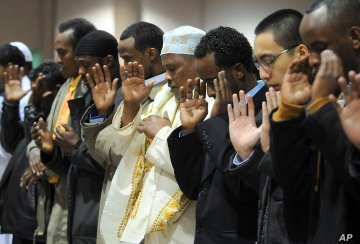 FILE - Several thousand Muslims pray together to mark the Eid al-Adha holiday Monday Dec.8, 2008 at the Minneapolis Convention Center.