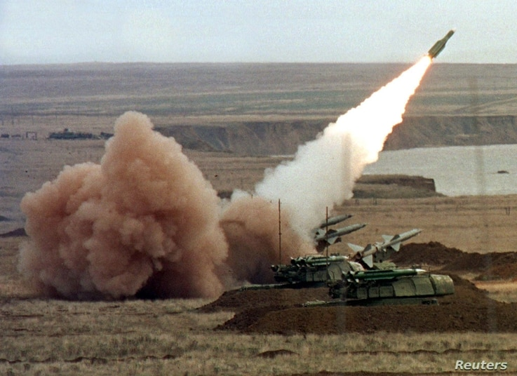 """A """"Buk"""" anti-aircraft battery launches a ground-to-air missile during the Ukrainian army's """"Duel-99"""" military maneuvers at the Chauda firing ground in the Crimean peninsula, October 12. The Russian air force said on Tuesday Moscow has agreed to allow..."""