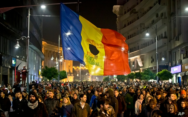 Romanians fill the Calea Victoriei, a main avenue of the Romanian capital, during a large protest in Bucharest, Romania, Nov. 3, 2015.