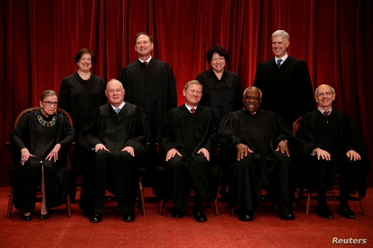File -- U.S. Supreme Court justices, front row, from left, Ruth Bader Ginsburg, Anthony Kennedy, Chief Justice John Roberts, Clarence Thomas and Stephen Breyer; back row, from left, Elena Kagan, Samuel Alito, Sonia Sotomayor and Associate Justice Nei...