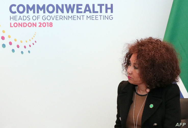FILE - South African Minister of International Relations and Co-operation, Lindiwe Sisulu, listens during bilateral talks with Britain's Foreign Secretary Boris Johnson in central London, April 17, 2018.