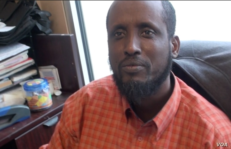 """We have no problem with other communities,"" Somali store owner Abraham told VOA. ""We live side by side, peacefully."" (G. Flakus/VOA)"