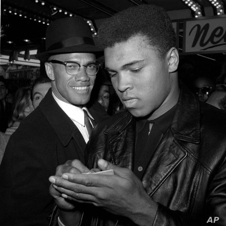 FILE - World heavyweight boxing champion Muhammad Ali, right, and Black Muslim leader Malcolm X in New York City, March 1, 1964. Ali died Friday in Phoenix, Arizona, at age 74.