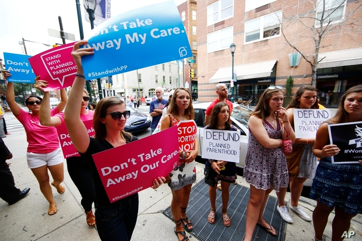 Opponents and supporters of Planned Parenthood demonstrate July 28, 2015, in Philadelphia.