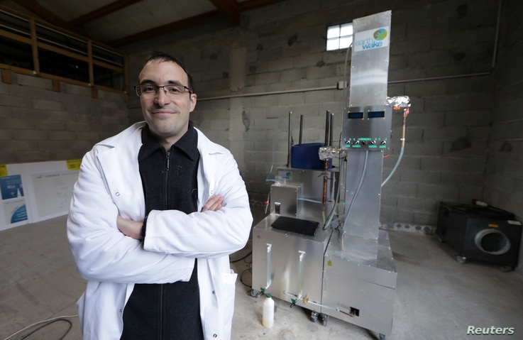 Christofer Costes, a French inventor who created a machine that turns plastic waste into fuel, poses with his invention in Puget-Theniers, France, Dec. 14, 2018.