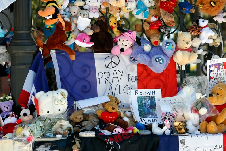 Dolls and teddy bears are placed at a memorial in a gazebo on the Promenade des Anglais in Nice, southern France on July 20, 2016.