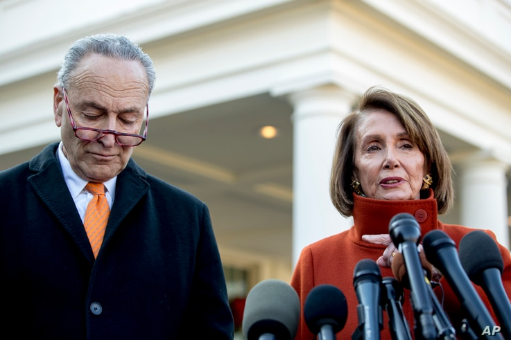 House Minority Leader Nancy Pelosi of Calif., right, accompanied by Senate Minority Leader Sen. Chuck Schumer of N.Y., left, speaks to members of the media outside the West Wing of the White House in Washington, Dec. 11, 2018.