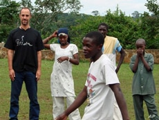 Justin Silbaugh with students in Uganda