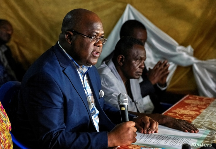 FILE - Felix Tshisekedi, leader of Congolese main opposition the Union for Democracy and Social Progress (UDPS) party, addresses a news conference in Limete Municipality of Kinshasa, Democratic Republic of Congo.