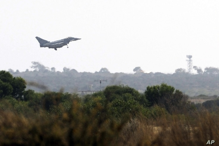 A British Typhoon fighter jet comes in to land at a British air base in Akrotiri, Cyprus, Aug. 29 2013.