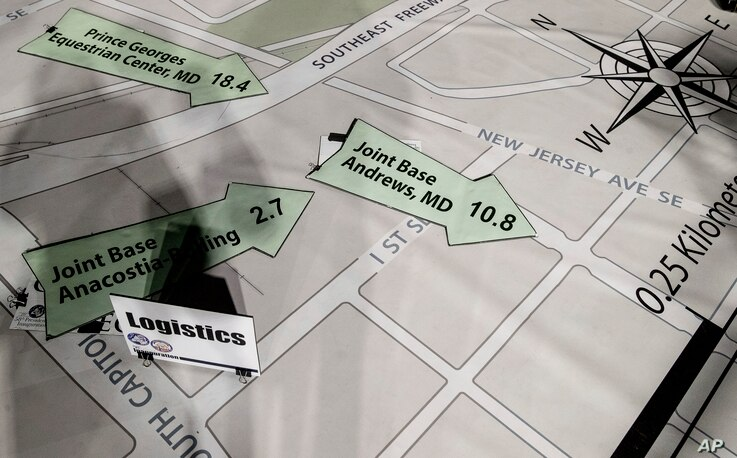 Directional signs are displayed on a giant planning map during a media tour highlighting inaugural preparations being made by the Joint Task Force-National Capital Region for military and civilian planners at the D.C. Armory in Washington, Dec. 14, 2...