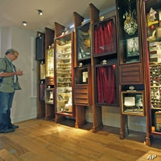 A journalist inspects artifacts from an exhibit at the Museum of Innocence in Istanbul, Turkey, April 27, 2012.