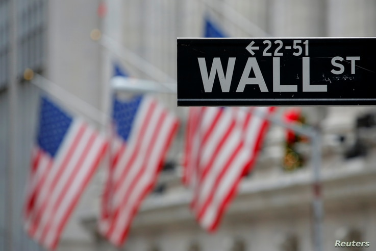 FILE - A street sign for Wall Street is seen outside the New York Stock Exchange (NYSE) in Manhattan, New York City, Dec. 28, 2016.