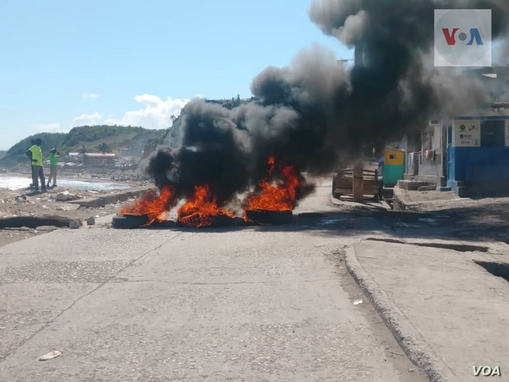 On Feb. 11, 2019, flaming tires block a road in Jeremie in Haiti's Grande Anse department, located in the southwest.
