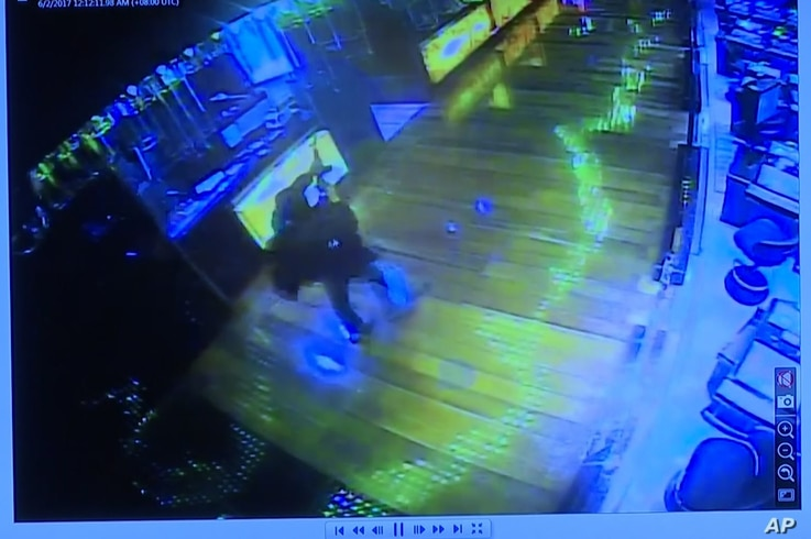 This image taken from TV of CCTV video shows a gunman firing a weapon into the air inside a casino in the Resorts World Manila complex before starting fires and firing on security forces, June 2, 2017. Philippine police say the attacker was a tall, E...