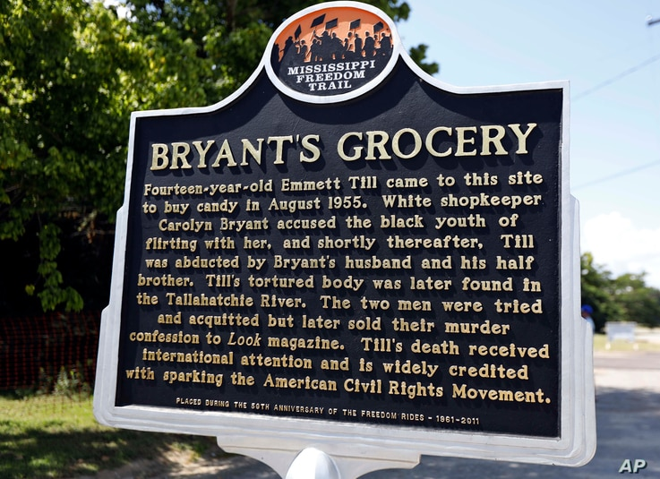 A Mississippi Freedom Trail marker recaps the significance of Bryant's Grocery and Meat Market, left, now in ruins, in Money, Miss., where in 1955, 14-year old Emmett Till allegedly whistled, grabbed and made sexual advances to a white woman.