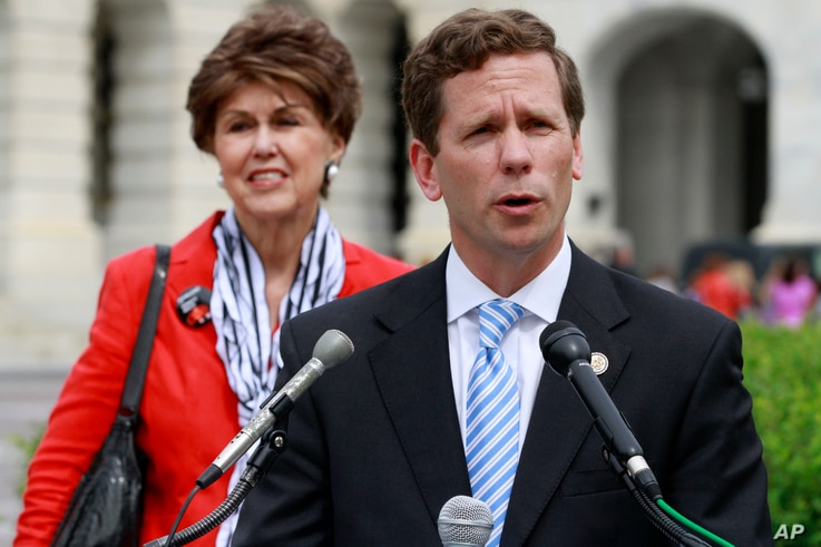FILE - Rep. Robert Dold, R-Ill., right, speaks during a news conference on Capitol Hill.