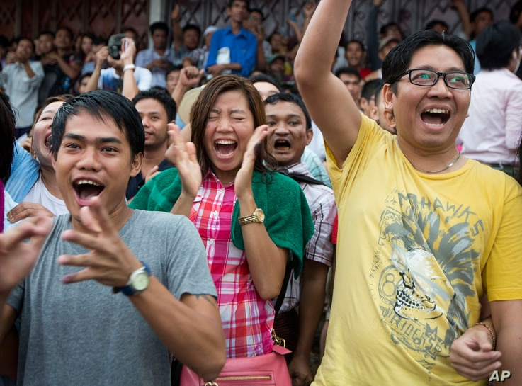 Supporters of Myanmar's National League for Democracy party cheer as they watch early voting results outside the NLD headquarters in Yangon, Myanmar, Nov. 8, 2015.