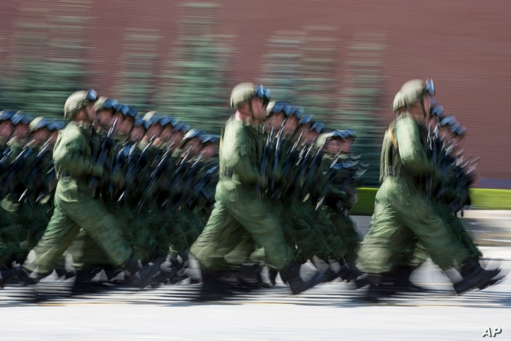 """FILE - Russian paratroopers march during the celebrations of Paratroopers Day in the Red Square in Moscow, Russia, Aug. 2, 2017. The Russian military says major war games, the Zapad (""""West"""") 2017 maneuvers, would include 13,000 Russian and Belarussia..."""