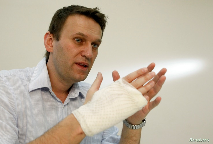 Russian opposition leader and anti-graft blogger Alexei Navalny speaks during an interview with Reuters at his office in Moscow, April 15, 2013.